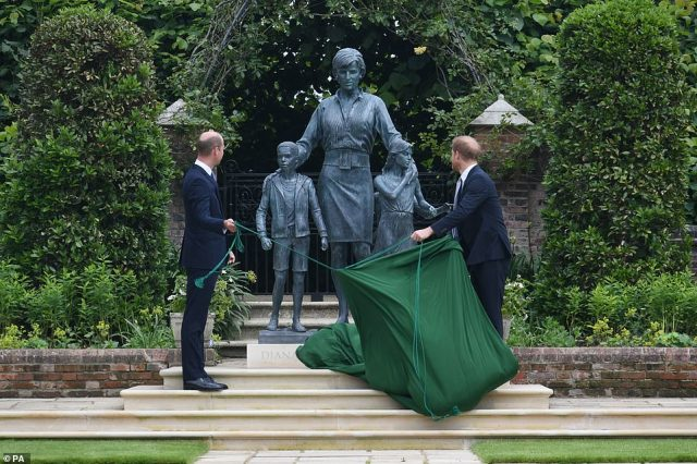 The bronze made by Ian Rank-Broadley shows Diana with her arms around two children with another child following behind, and towered over the brothers as they revealed it to the world this afternoon.
