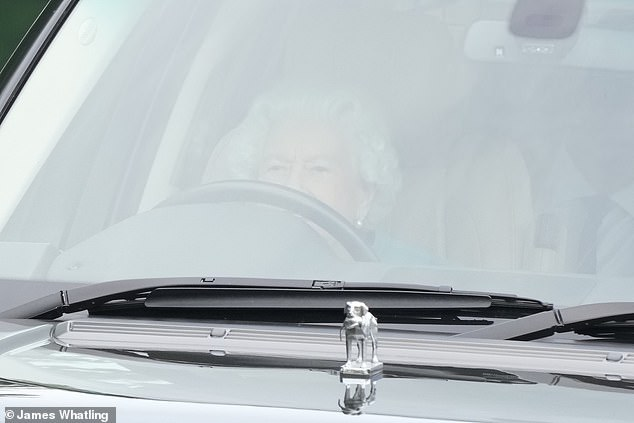Her Majesty was pictured behind the wheel as she drove into the Royal Windsor Horse Show in Windsor