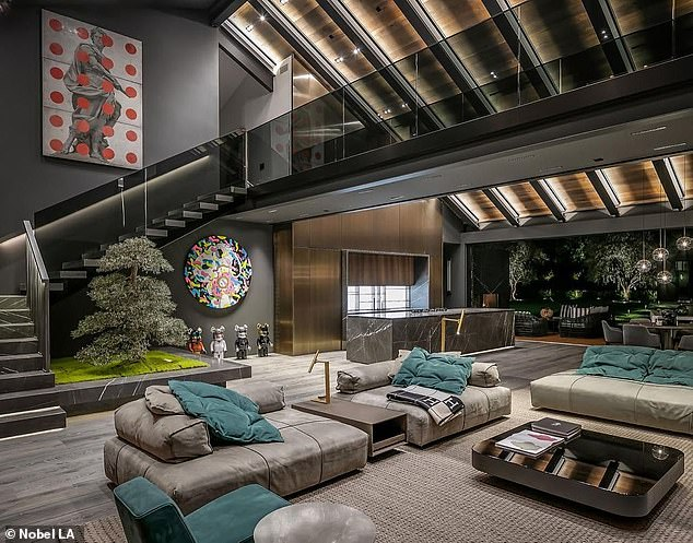 Modern: The athlete's home features an ultra-modern design throughout. The first floor opens out to a minimally designed open-plan kitchen and living area (pictured)