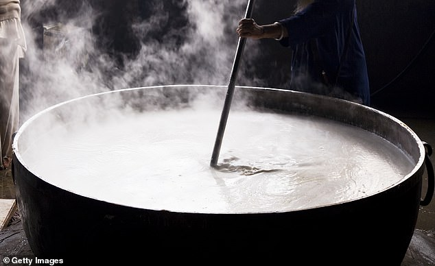 A chef in Iraq has reportedly died after falling into a large pot of boiling soup on the floor of a kitchenat the Hazel wedding hall in Zakho. Pictured: A large pot of food cooking [file photo]
