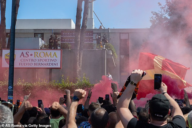 Roma supporters show their passionate support for their new manager on Friday afternoon