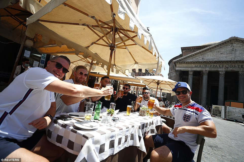 England supporters drink beer as they gather in Italy's capital city Rome ahead of Ukraine versus England later on Saturday evening