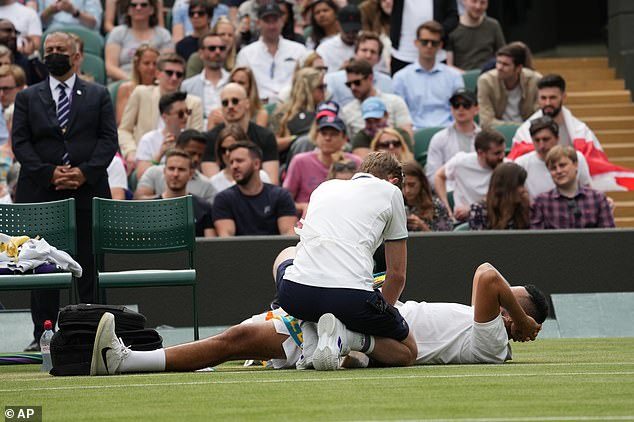 Kyrgios dropped to the floor and had to receive treatment before the end of the opening set
