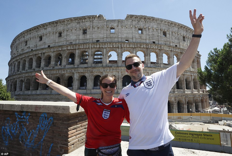 England fans wearing football jerseys pose in front of theColosseum hours before kickoff tonight