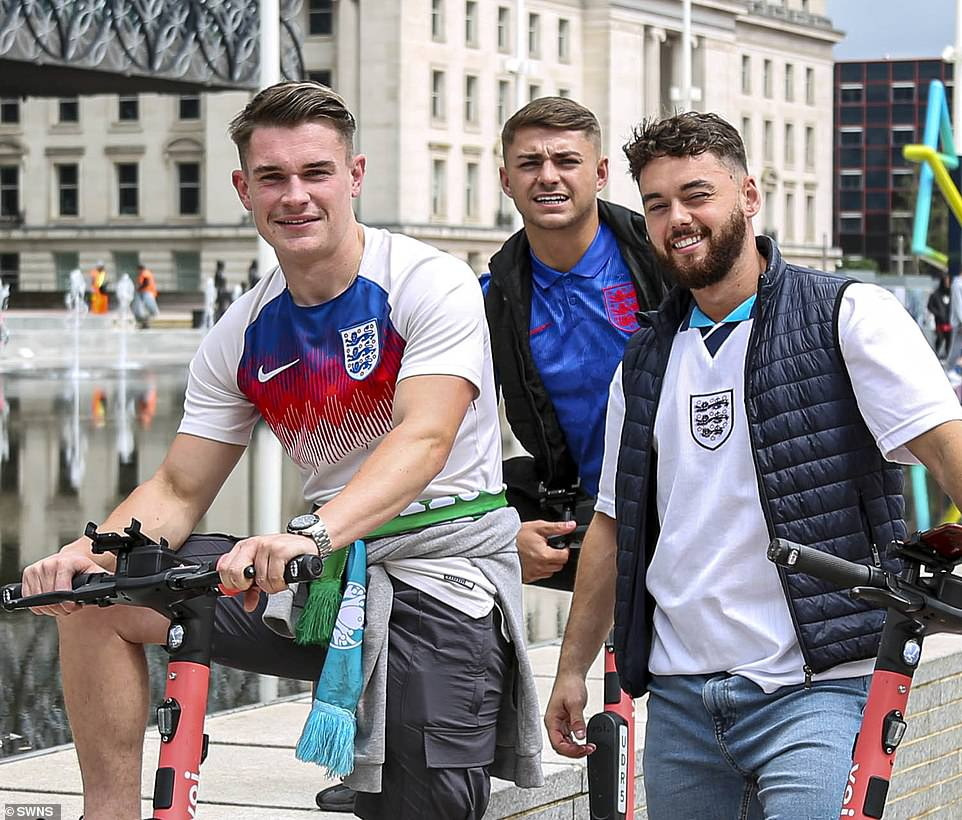 England fans look cheerful as they pose in Centenary Square in Birmingham today ahead of England's Euro 2020 match