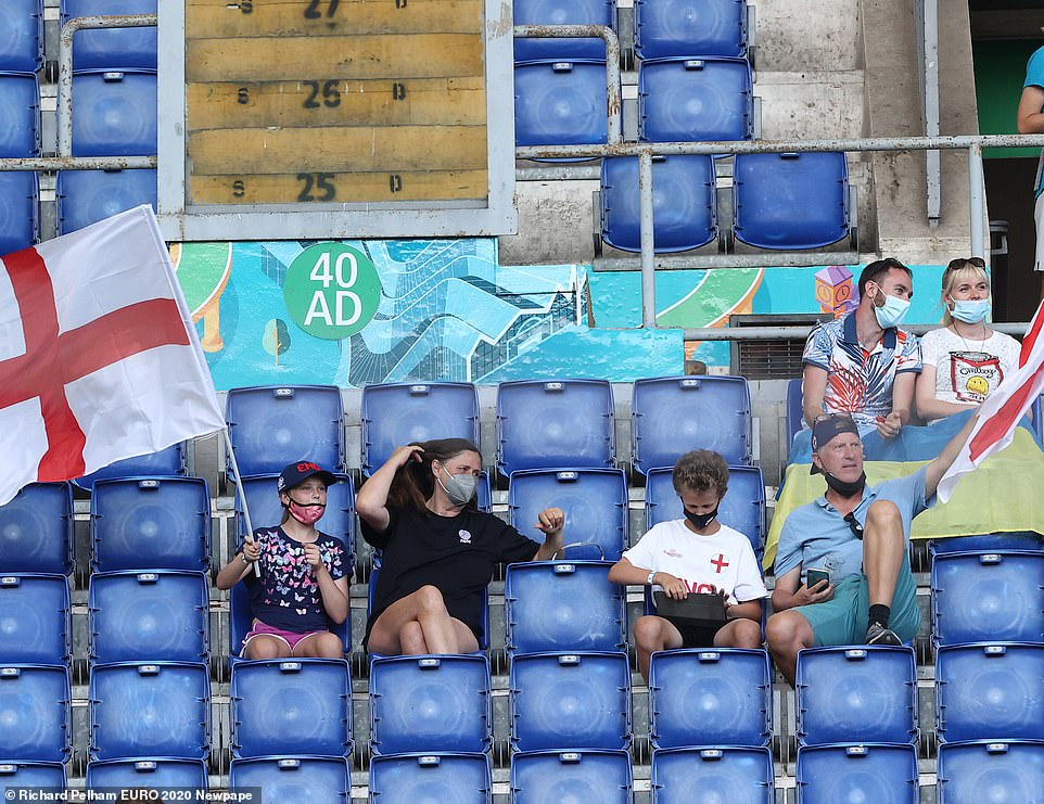England fans have started to arrive and wave flags at the Stadio Olimpico, Rome ahead of tonight's crunch kickoff with Ukraine
