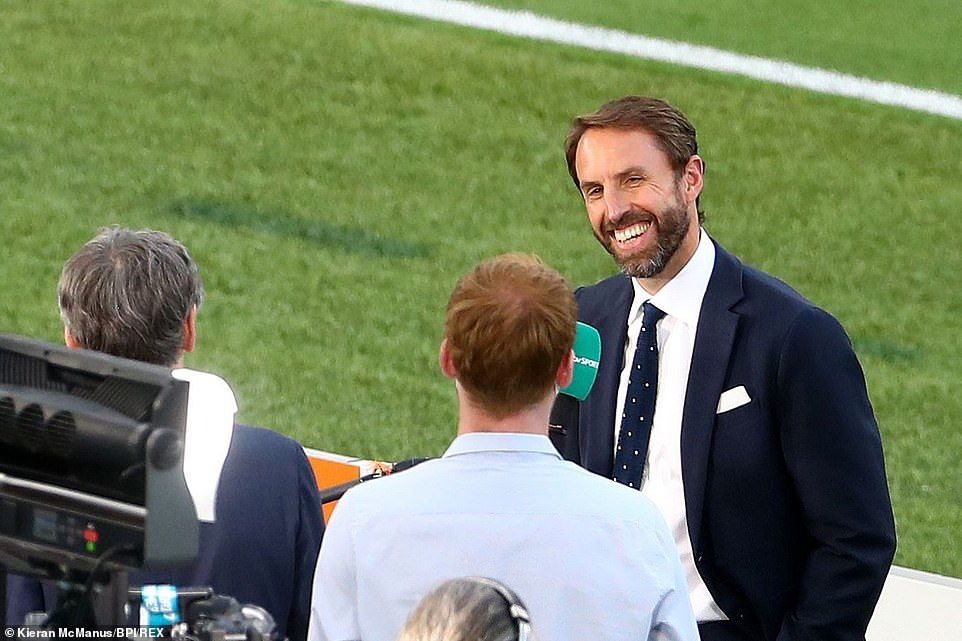 As England fans both at home and abroad prepare for the Euro 2020 quarter final match with Ukraine one message is clear: 'Trust in Southgate'. Pictured: England manager Gareth Southgate speaks to the media ahead of tonight's match