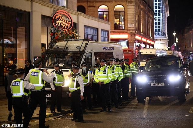 A heavy police presence has been pictured in the capital as fans' celebrations are monitored