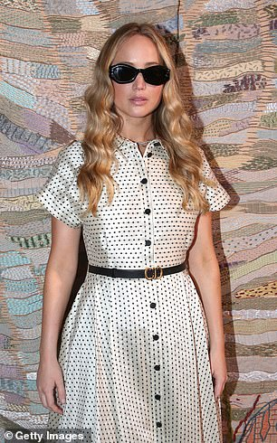 Glam: Jennifer looked stunning as she posed for photographs at the event