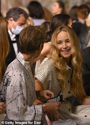 Sweet: Jennifer appeared animated while chatting to a pal on the frow