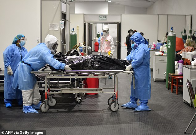 Medical personnel remove the corpse of a Covid-19 victim from Honorio Delgado Hospital in Arequipa, Peru where the Lambda variant accounts for almost 81 per cent of the country's cases since April
