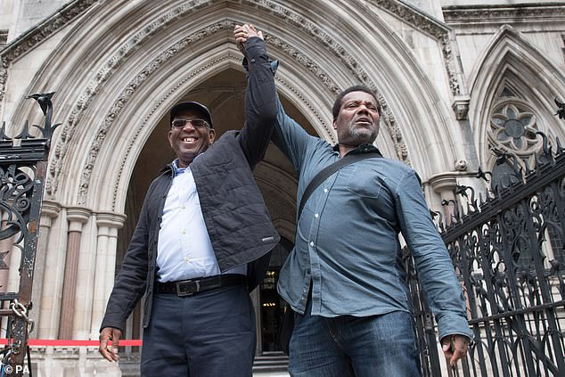 Three men have had convictions for attempting to rob a corrupt detective quashed. Pictured: Paul Green (left) and Cleveland Davidson celebrate outside Royal Courts of Justice, London