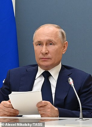 Vladimir Putin takes part in a session of the 8th Forum of Russian and Belarusian regions on July 1, 2021