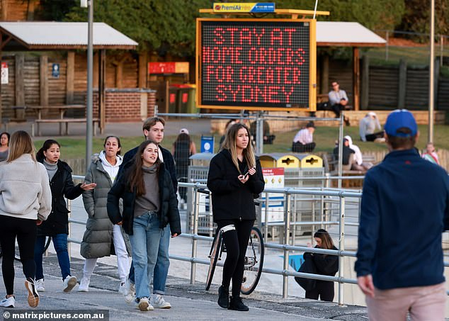 Sydney and surrounding areas will remain in lockdown for at least another week as the city's rampant Covid-19 outbreak continues to spread throughout the western suburbs (pictured, Sydneysiders stroll around Bondi Beach during lockdown on Tuesday)