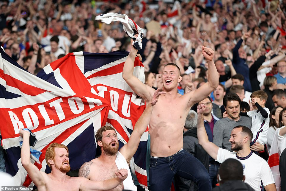 Crowds of fans leap on seats and wave their flags as Gareth Southgate's squad beat their rivals following a Wembley thriller