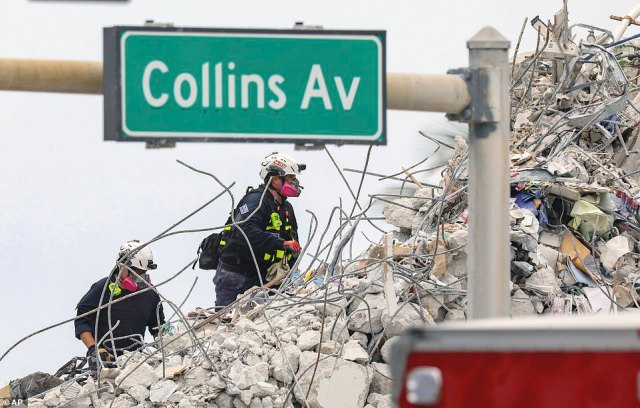 Workers sifted through the rubble of the areas opened up Sunday when the still-standing portion of the Champlain Towers South building was demolished