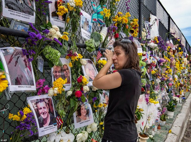Gini Gontevisits the Surfside Wall of Hope & Memorial on Wednesday as she honors her friends Nancy Kress Levin and Jay Kleiman, who were identified among the dead the previous day