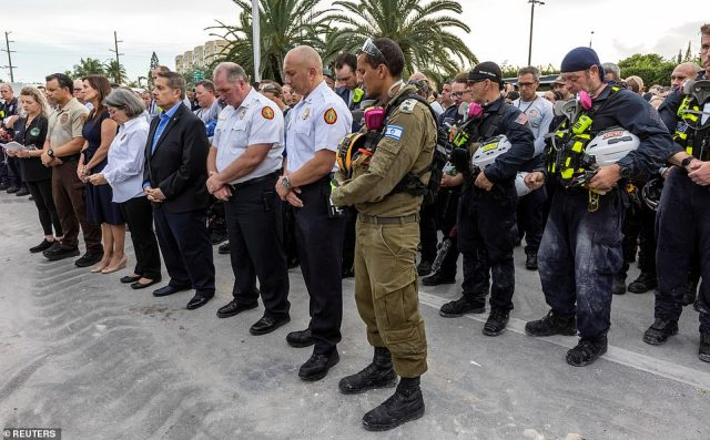 Miami-Dade County officials joined with the rescue workers for Wednesday's moment of silence