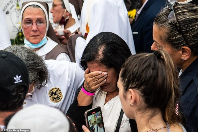 A relative of a victim of the collapse mourned alongside the rescue workers