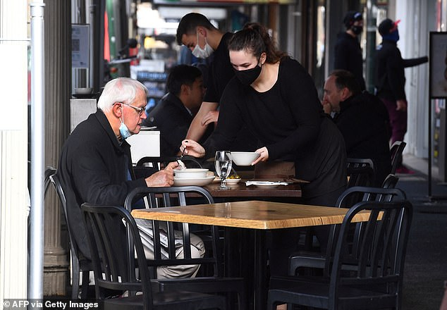 More than 10million Australians should start receiving tax cuts of up to $1,080 during the next few days. Pictured is a Melbourne cafe worker