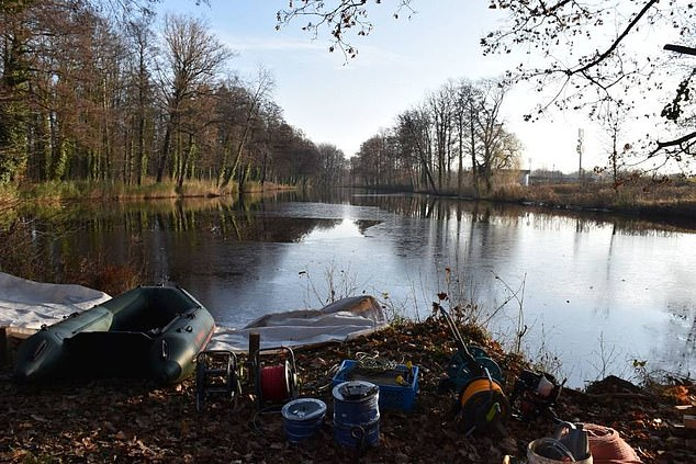 Piotr Koper said he had recently carried out a preliminary search of the lake 90 miles away from Walbrzych in southwest Poland using geo-radar and found 'steel' which could belong to the trucks