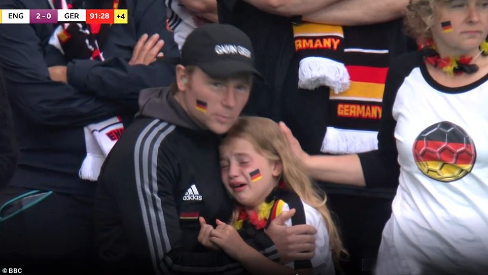 Pictured, the German girl pictured during the BBC's coverage of the England-Germany match on June 29. The image was shared on social media with abusive and xenophobic comments, resulting in an online fundraising campaign