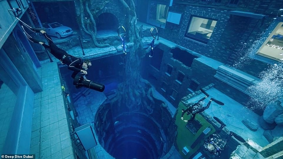 Deep Dive opened its doors to invited guests in late June, and includes a massive underwater city of abandoned homes and an arcade