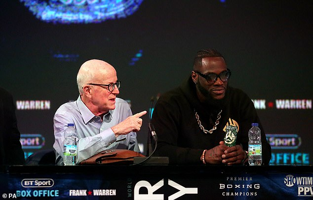 And the 'Bronze Bomber' (right) told his manager Shelly Finkel (left) that he felt it was Fury's fault