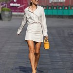 Vogue Williams puts on a VERY leggy display in a white mini skirt and silk blouse 💥💥