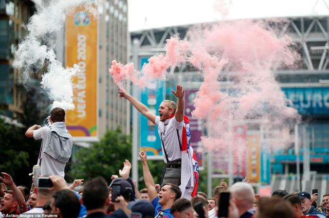 England fans with flares gather on Wembley way outside Wembley stadium ahead of the match
