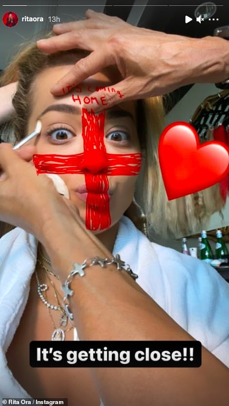 Excitement: Rita shared more snaps getting ready for the game having her makeup done before showing off the results including a red lip