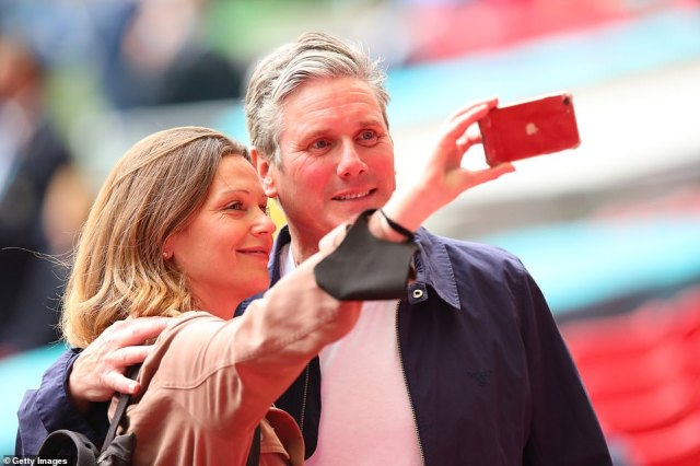 Labour leader Sir Keir Starmer poses for a selfie with his wife Victoria before the game starts