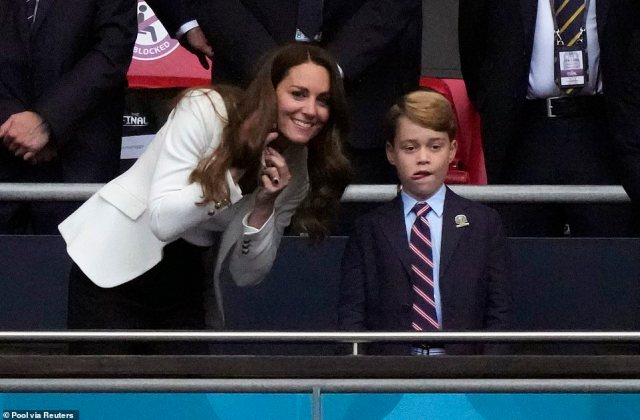 Kate and Prince George watch on as the match gets underway