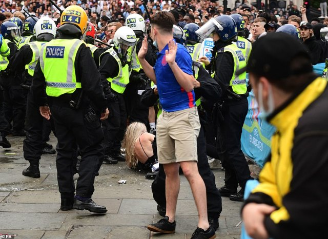 Police clash with football fans at Trafalgar Square as the match between the Three Lions and Italy kicks off