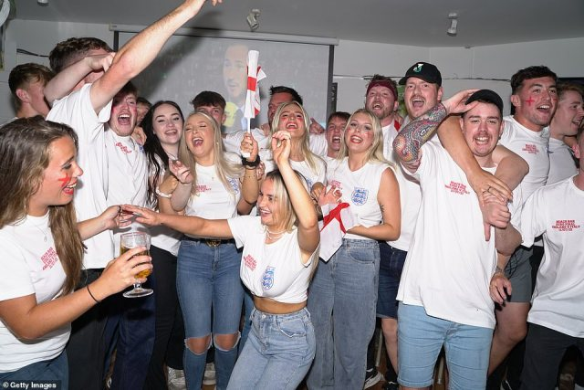 Fans in the Beach Bar in Torquay celebrate as England open the scoring in their Euro 2020 final against Italy at Wembley Stadium