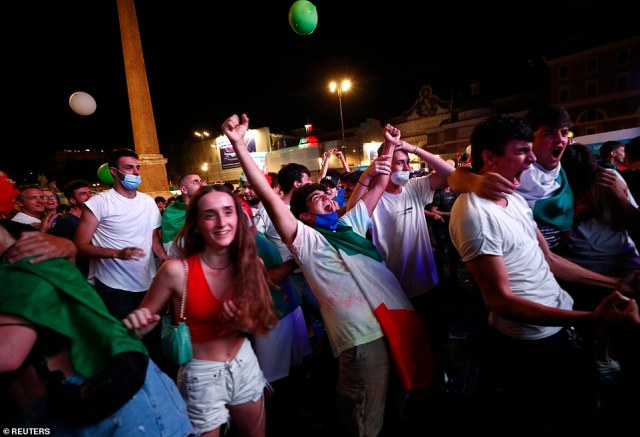 Jubilant Italian fans celebrate their equaliser at the Piazza del Popolo in Rome