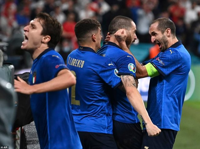 Italy's Leonardo Bonucci2nd right, celebrates with Italy's Giorgio Chiellini, right, after scoring his sides first goal during the Euro 2020 soccer championship final