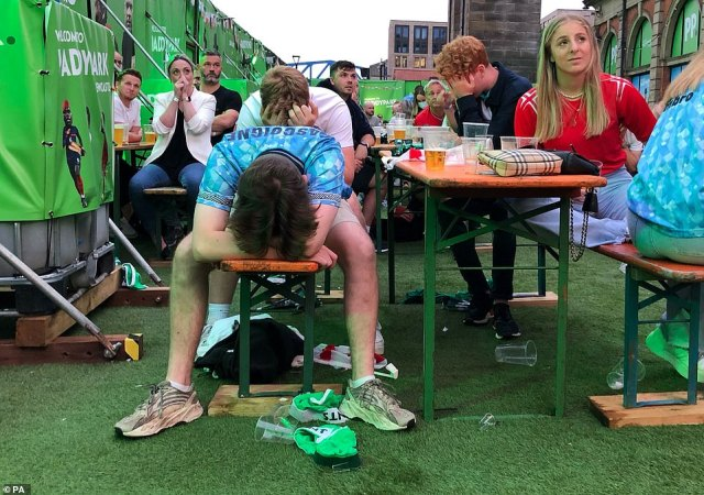 England fans despair after Italy equalise in the PaddyPark fanzone beside the River Tyne, Newcastle, watching the Euro 2020 Final