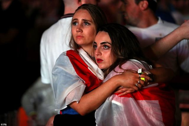 England fans are dejected after England lose the game on penalties at Vinegar Yard, London