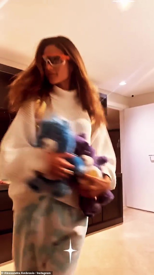 Bedroom talk: Ambrosio made her spot-on turn and headed back tot he doorway, all while holding on tight to her stuffed animals