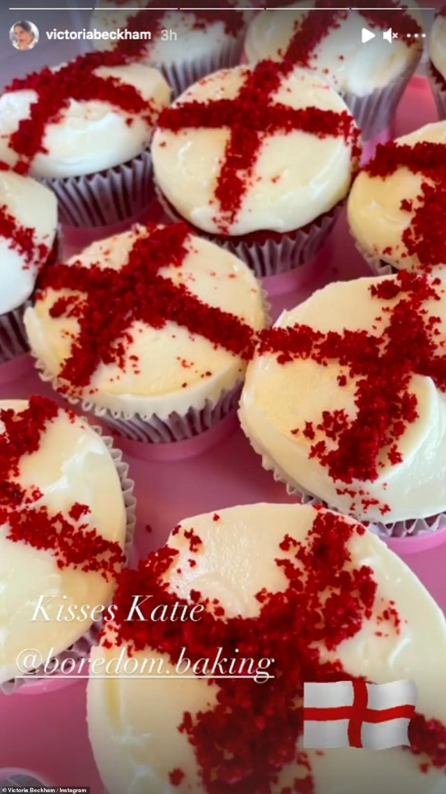 Yum: Victoria Beckham also showed off a tray of delicious looking cup cakes with an England flag design on them