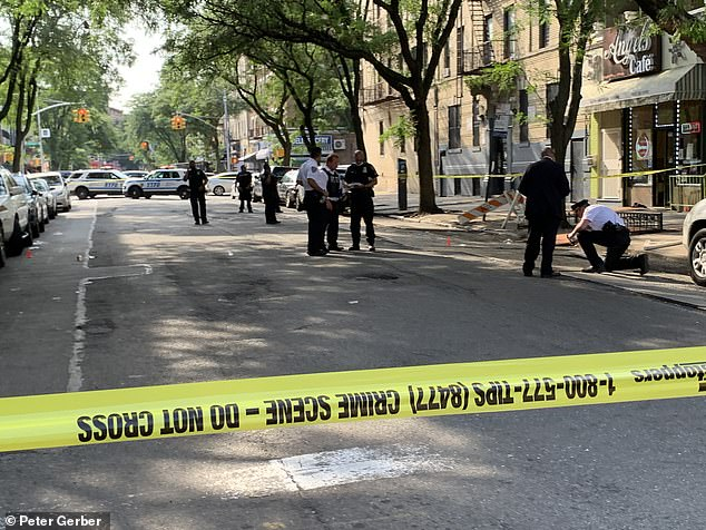 Weapon manufacturers could face a lawsuit for harming the public by failing to take steps to prevent firearms from being sold unlawfully in New York, for instance. Pictured in this photo, NYPD investigate the scene outside Angels Café where 13-year-old Jaryan Elliot was shot Sunday afternoon