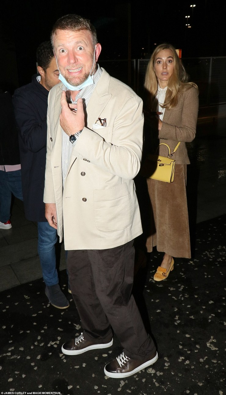 Chic: Guy's wifeJacqui Ainsley Ritchie looked stylish in a camel coloured ensemble