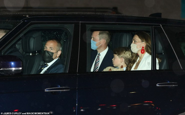 Heading home: The family looked serious as they stepped out following the excitement of the match