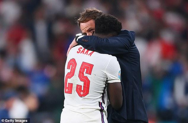Gareth Southgate hugs Bukayo Saka after the Arsenal star missed the decisive spot-kick