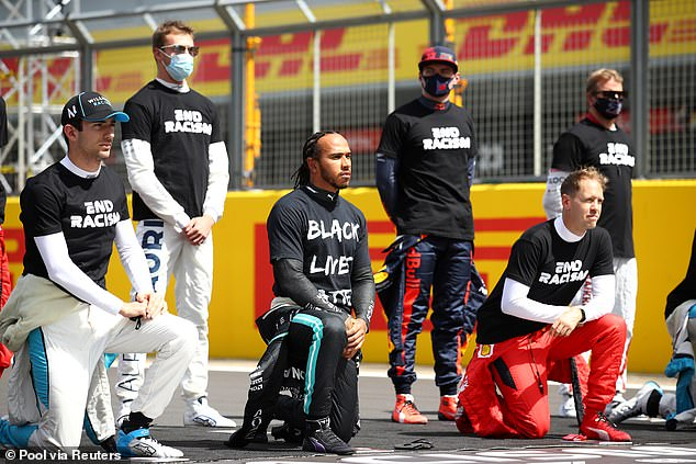 Taking the knee: Hamilton wore Black Lives Matters t-shirts before Grand Prix races last year and took the knee