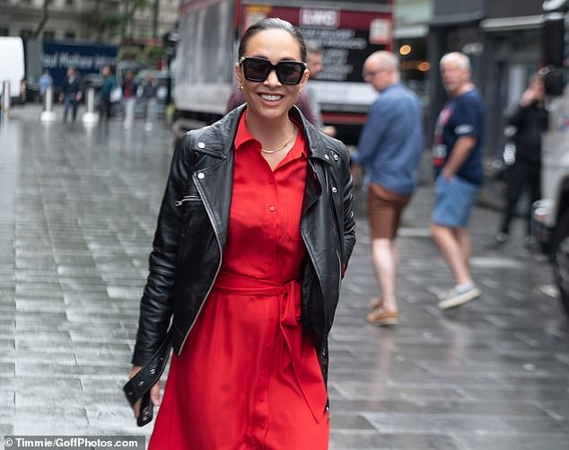 Summer vibe:Despite the rainy weather, Myleene kept it summery with a pair of black sunglasses with gold detailing