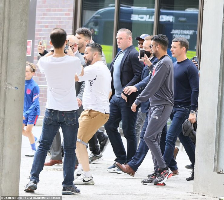 Soaking it up: Wayne Rooney was seen getting into the football spirit with fans