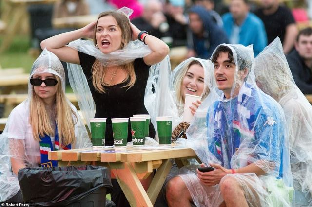 Football fans in Glasgow, Scotland, watched last night's Euro 2020 final in the rain as more thunderstorms and heavy showers are forecast over the country today