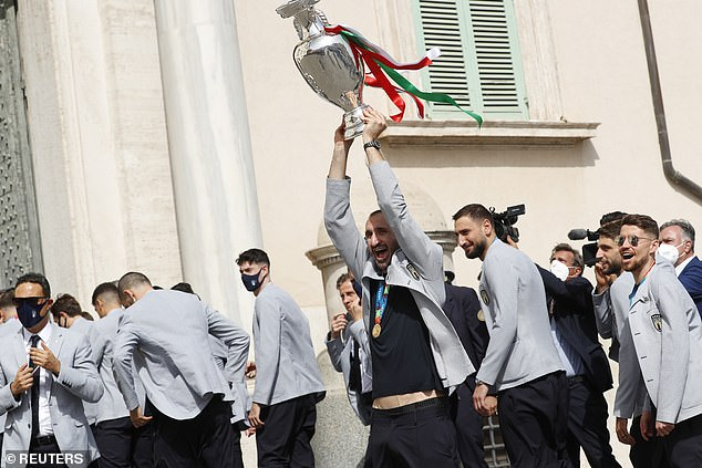Chiellini hoisted the trophy aloft as a group of fans gathered to cheer their heroes